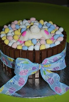 Chocolate Bunnies around the sides with Bird's Eggs & chocolate bunny.  Surround with coconut colored green.  SO cute!