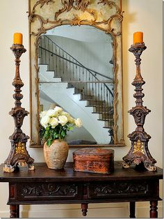 beautiful candlesticks, mirror, and stairs..