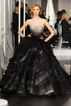 "Tammy, on the runway, in Christian Dior  beautiful black evening gown.  She looks  like a princess in this gown.  Maybe the  beast will come to save her and take her away to a pleasure palace somewhere on a secluded island.  ""Da plane, Da plane""..."