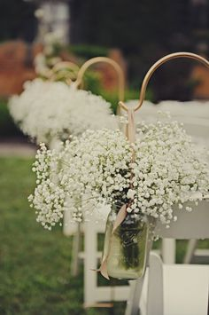 Baby's Breath in Mason Jars hung by Shepards Hook. I like the colour, less harsh than black.