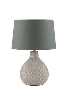 With a bulb shaped, intricately embossed ceramic base and wide grey shade, our petite table lamp will make an elegant feature in your living space.  Its Scandinavian inspired design combines simplistic style and delicate detailing for a pretty tabletop lighting solution.