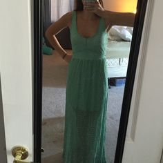 Green lace maxi dress Beautiful green maxi dress. Dress is made of a lacy/ mesh material and is sheer from the knees down. Very flattering on top and cute cut outs in back. Price is negotiable. New with tags never worn Boutique Dresses Maxi