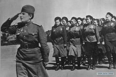 Soviet female soldier in military march in 1941