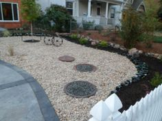 My xeriscaped yard - with wine bottle edging and design