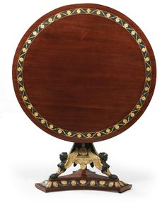 """Museum quality Viennese Empire table, Workshop of Josef Danhauser (Vienna 1780–1829) circa 1810/15. Made in mahogany, the lower part of the top with crossbanded veneering in cherry, set on a three-sided base with verde antico mouldings and gold painted parnassus grass ornament, set over columns supported by gold-painted sphinxes with the so called """"vergoldeten Holzbronzen"""" (gilt wooden bronzes) (shaped moulded"""