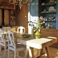 Axel Vervoordt's kitchen  rustic trestle table, blue painted cupboard