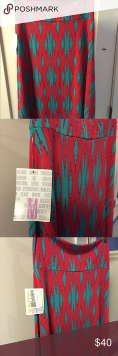 Azure Lularoe Skirt Aztec Print Pink and Teal Cute Pinkish and teal Azure Skirt!  Perfect for summer!  New with tags, didn't fit me when I got it a week ago!  Brand new print! LuLaRoe Skirts Midi