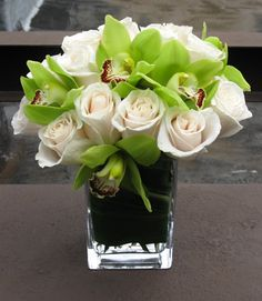 Calming white roses and crisp green orchids create a beautiful arrangement with accents of Hawaiian Ti leaf for luck. The perfect #NYC #Flower delivery to send to an employee who has recently welcomed an addition to his or her family