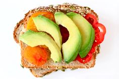 Sweet, juicy heirloom tomatoes and slices of just-ripe avocado work in perfect harmony no matter what you serve them on, but a slice of seven-grain bread adds a perfect amount of texture and crunch.