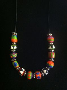 $28.00   This leather beaded necklace is about 18.25 inches long, and the hand crafted and handmade beads are approximately 8 to 9mm. The colorful beads are accented with sterling silver Balinese beads.  https://www.etsy.com/listing/153987831/colorful-leather-beaded-necklace?.