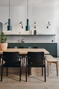 Kitchen-cum-dining room with teal accents. For more, visit houseandleisure.co.za