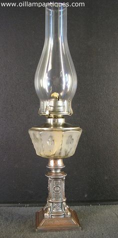 The Edward Miller & Co. catalogue from 1881 included a lamp that is essentially the same as this one. The lamp still retains most of its original finish, though some copper is showing through around the lower edge.