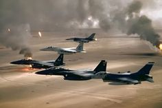 USAF F-16's flying over burning Kuwaiti oil fields
