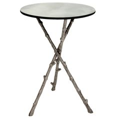 This unusual twig legged side table with antique mirror glass is perfect to display accessories in style. The three metal twig designed legs form an attractive tripod stand to support the round antique finish mirrored glass top.