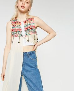 EMBROIDERED WAISTCOAT WITH POMPOMS