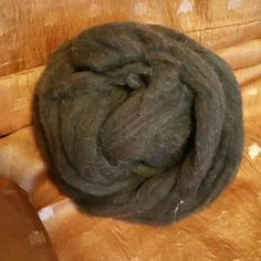 This beautiful fine wool dyes very well. I over dyed it with emerald green