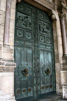 The bronze doors of Basilica Sacre-Coeur, Paris, France by Virginia