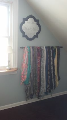 Was sick of trying to dig through my closets for the many scarves I have, so, thanks to Pinterest, came up with the idea to hang a decorative curtain rod under a pretty little mirror in my bedroom and hang all my scarves. I love it! it adds some color to my room and I can see my full selection of scarves for when I'm putting together an outfit.