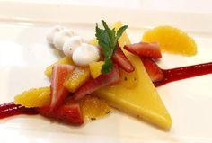 Bacchus serves a vibrant lemon cream bar with strawberry-citrus salad, baked meringue and amaretti crumbs.