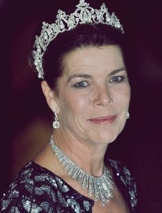 Princess Caroline in her Paternal Grandmother's (Princess Charlotte) tiaras. The pearl drop tiara and wearing the fringe diamond tiara as a necklace.