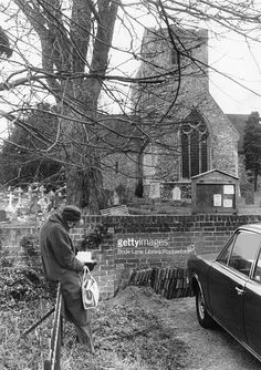 A fan waits outside the parish church of St Mary in Cholsey, hoping to glimpse the funeral of author Agatha Christie, 16th January 1976