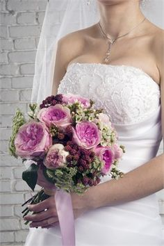 Soft shades of green and pink making it an ideal bouquet for shabby chic weddings.