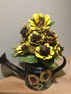 Pinecone sunflowers in metal watering can