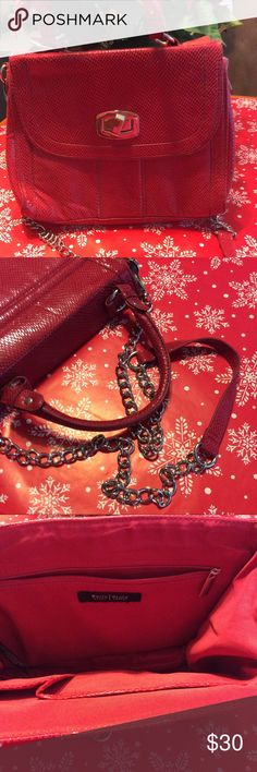 """~Red~ WHBM Crossbody A brand new crossbody by White House Black Market. Removable chain handle with a drop of 22"""" and handles with drop of about 5"""". Pretty Christmas Red Bag snaps together at sides to snug up. Clean inside and out. There are a few minor scratches on golden hardware. Inside has 1 zip and 2 slip pockets one the largest of these will hold an iPhone 7+. L8.5"""", 11"""" W , 3.75"""" D.  Thanks so much for visiting my closet! Happy Holidays my friends! 🎉❤️💙 Roni White House Black Market…"""
