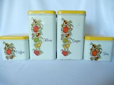 vintage kitchen canister set Cheinco Housewares 4 tin by brixiana vintage kitchen canister set, made by Cheinco Housewares, New Jersey. 4 white tin canisters with yellow lids, 2 larger, 2 smaller, with a veggie design on the front of the canisters (tomatoes, mushrooms, radishes, and herbs).