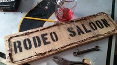 This saloon sign was made from left over scrap pallet wood. I also used rusty barbed wire I found in a field.