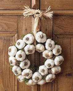This garlic wreath will keep the vampires far away.  You can buy them at craft stores and William & Sonoma but it is also very easy to make. Purchase a wreath base with nothing on it from a craft store & a bulk bag of garlic from your local grocery store. You can pin them w-wooden skewers, tie them w-string, even glue would work. Attach them to your base, add a hanging string & a removable hook to your door. The best ones have more than one row of garlic bulbs going around.