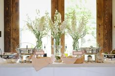 Tall buffet flowers white delphinium wedding flowers calie rose