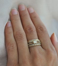 Edgy and sophisticated, the Blaire stack shines with alternating shapes and patterns making her both sexy and sweet. A posh Emerald Cut diamond sits bezeled in 14K yellow gold on a beaded band, nestled between a tiny diamond eternity band and an organic golden band of diamonds pods. There are countless ways to wear these beautiful stacking rings and mix them into your everyday jewelry ensemble.