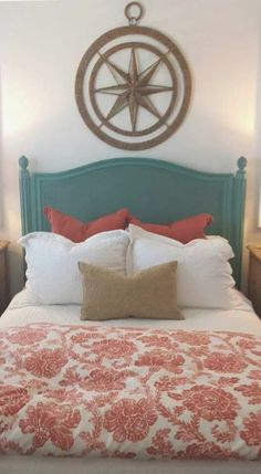 Love the nautical star over the bed! beach house bedroom with teal headboard and orange and white bedding.