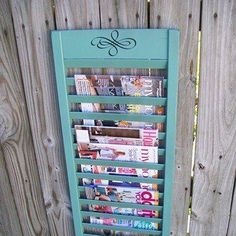 Magazine display ( Window Shutter). Cute DIY idea. Love the teal color.