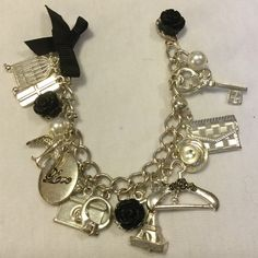 "Betsey Johnson Charm Bracelet Measures 8"" ..only worn a couple of times Betsey Johnson Jewelry Bracelets"