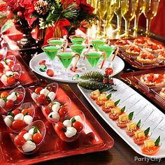 Host a gourmet tasting party with mini plates and bowls that hold just enough for one. Display rows of mini bowls, tasting spoons and plates with petite servings of mini tartlets, ravioli or caprese salad.  Mini creme de menthe martinis with a red sugar rim and a candy cane garnish make a festive welcomes drink.