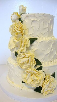 #Pastel yellow wedding ... Love this texture!  three tier textured white buttercream pale yellow sugar flowers Custom Cakes Gallery - Wedding Cakes - TipsyCake Chicago