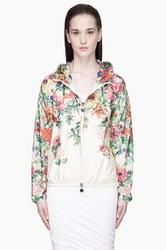 Moncler Ivory Multicolor Giasone Flower Print Nylon Jacket -  Moncler Ivory Multicolor Giasone Flower Print Nylon Jacket Moncler Long sleeve hooded nylon jacket in ivory white. Multicolor detailed flower print throughout. Elasticized hood brim. sleeve cuffs. and hem. Two_way zip closure and seam pockets at front. Raglan sleeves. Logo applique at exterior...