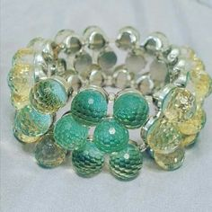 Light green bangle stretchable ** New** Strech bangle. Silver inside. Fantasy jewelry. Bought at Madeline boutique. Jewelry Bracelets
