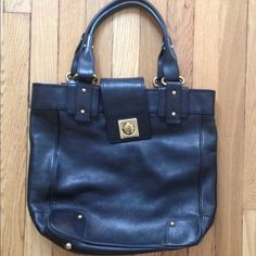 Banana Republic Black Leather Bag. Banana Republic black leather bag. Gold closure and studding. Corner wear pictured. No trades. Bundle discount & all offers considered! Listed elsewhere on PM for $68! Banana Republic Bags Shoulder Bags