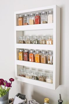 How to build a DIY spice rack that can be mounted on a wall. This wood spice rack will help to organize all your spices, look pretty, and save drawer and closet space since it hangs on the wall. diy tips DIY Wall Spice Rack - Angela Marie Made Wall Spice Rack, Wall Mounted Spice Rack, Kitchen Spice Racks, Diy Spice Rack, Diy Kitchen Storage, Diy Storage, Kitchen Organization, Hanging Spice Rack, Spice Rack Organization