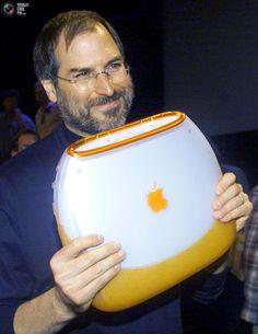 Apple Steve jobs clamshell iBook laptop orange colorful