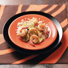 Cajun Shrimp Stir-Fry Recipe -Squash and red onion add color to this tasty, one-dish meal with just the right amount of Cajun kick. —Ginny Kochis, Springfield, Virginia