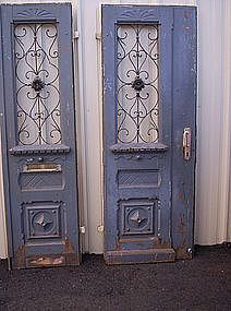 Beautiful French blue antique doors with wonderful decorative ironwork.  Great architectural pieces.  www.trocadero.com/mercibeaucoup