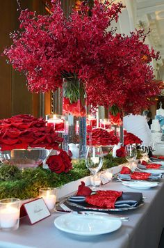Beautiful tablescape for red color schemed event. Could be Christmas, maybe in a tropical location, or a valentine soirée.