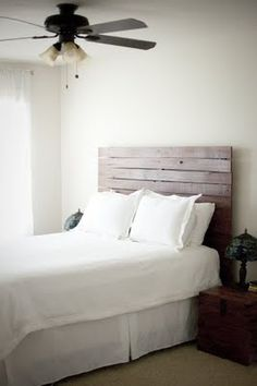 What a gorgeous headboard, out of a piece of old fence.