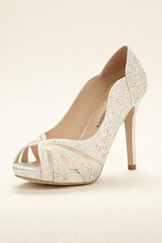 """Sparkle and shine all evening long!  This glamorous crystal encrusted pump features a peep toe and scalloped edge for a little extra drama that will perfectly compliment your favorite dress.  Heel height: 4""""  Fully lined.  Imported."""