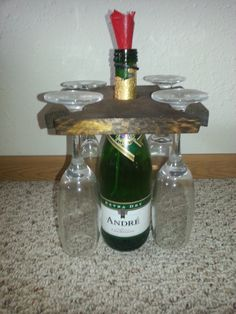 This DIY Champagne Bottle and Glass Holder is one of the easiest DIY wood projects. Create a portable and customizable wood craft caddy for wine or champagne bottles and 4 stemmed glasses.
