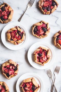 Our resident queen-of-desserts Katie Wahlman knows just how to get our mouths watering. These bumbleberry galettes will get you excited about spring baking.